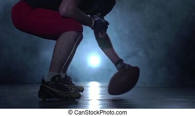 Transfer back rugby ball from player in american football....