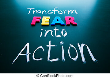 Transform fear into action concept, colorful words on blackboard