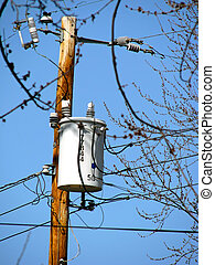 Transformer - a utility pole with electric power transformer