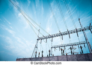 transformer substation against a blue sky ,electricity background