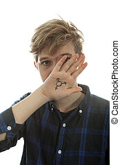 Transgender boy is hiding his face behind a hand