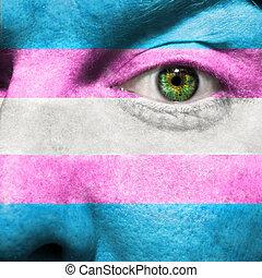 Transgender Flag painted on face to show Transgender Pride...