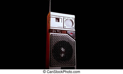 Transistor Radio, Vintage Portable Device on Battery Power, Close Up Spinning on Black Background 4k