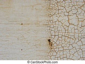 transition from smooth to cracked white paint surface...