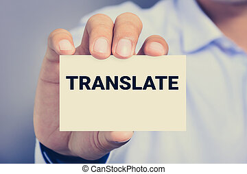 TRANSLATE word on the card held by a man hand