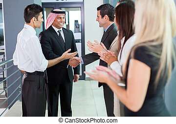 translator introducing arabian businessman to business...