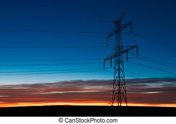 Transmission tower - Sunrise and a transmission tower in a ...