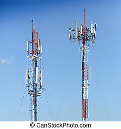 Transmission towers in blue sky background