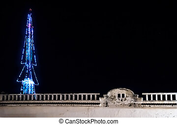 Transmitter tower decorated as christmas tree with colonial building, Merida, Yucatan, Mexico