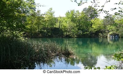 Transparent azure water in a river on Plitvice Lakes, in ...