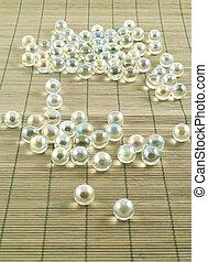 Transparent balls over bamboo mat