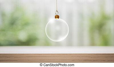 Transparent Christmas ball over wood table