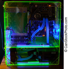 Transparent computer with liquid cooling and UV light