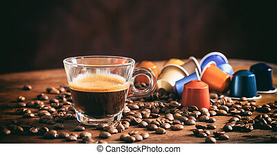 Transparent cup of espresso on a wooden table