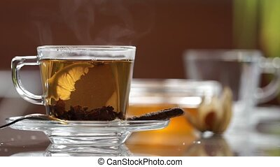 Transparent cup of tea on the table