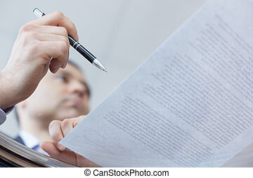 Transparent deal - Image of a businessman signing the ...