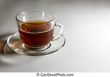transparent glass cup with tea