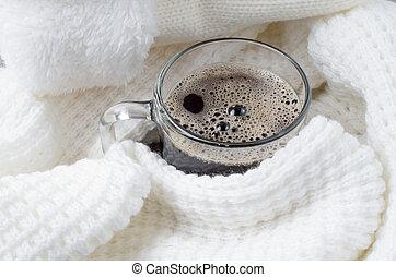 Transparent glass mug with hot coffee close-up