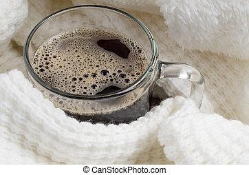 Transparent glass mug with hot coffee closeup