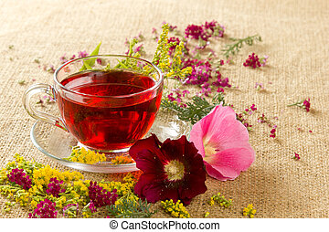 transparent glass mug with red floral tea