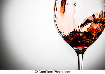 Transparent glass on blank background with red wine