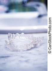 Transparent plastic splint for dental alignment