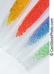 transparent polymer resins in test tubes - transparent dyed...