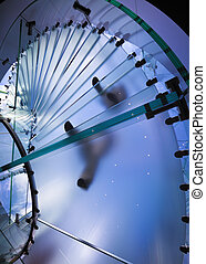 Transparent spiral glass staircase