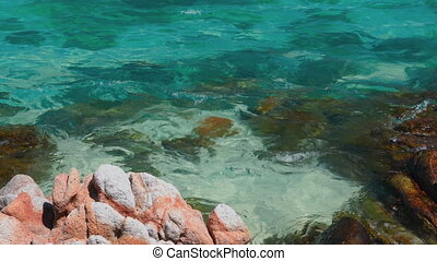 Transparent turquoise sea water surface on exotic paradise ...