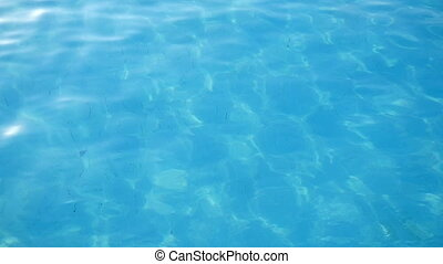 Transparent waters of the Mediterranean sea playing with light shades and sparkles
