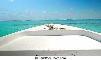 Transport Boat Anchored next to Coral Reef - Front of the...
