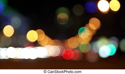 Transport goes on the night street of the big city, transition of the out-of-focus image to the sharp