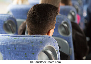 close up of man sitting in travel bus