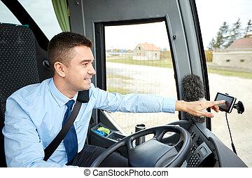 bus driver entering address to gps navigator - transport,...