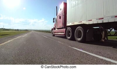 Vehicle shot of semi trailer freight truck on highway