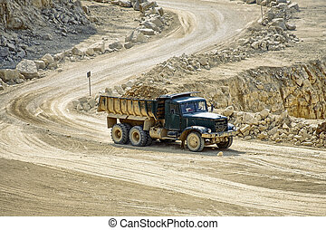 Transport trucks in the dolomite mine
