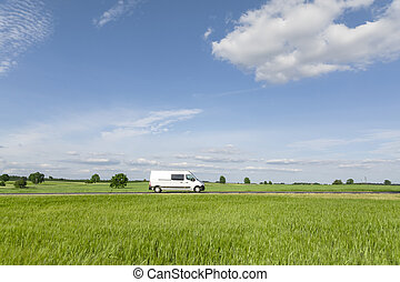 Transport van driving on the road