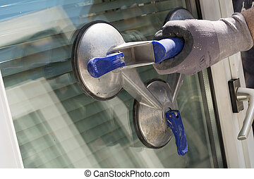 Transport windows with suction cup - Windowpane with a...
