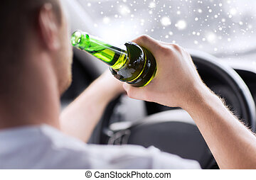 close up of man drinking alcohol while driving car