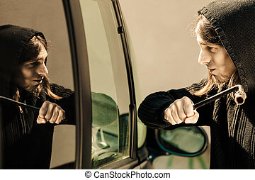 Transportation and crime- thief breaking car window