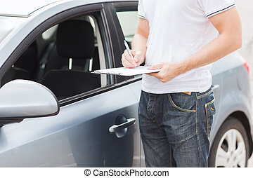 man with car documents - transportation and ownership...