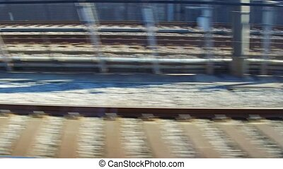 view to railway from moving train - transportation and...