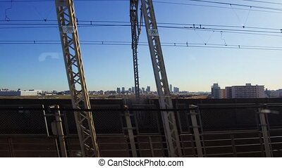 view of city and railway from moving train - transportation...
