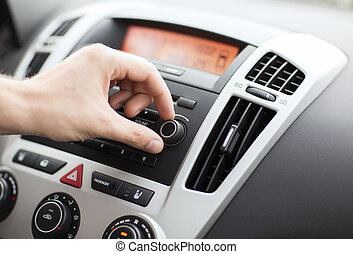 man using car audio stereo system - transportation and ...