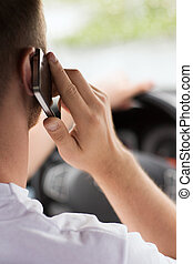 man using phone while driving the car - transportation and...