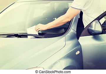 parking ticket on car windscreen