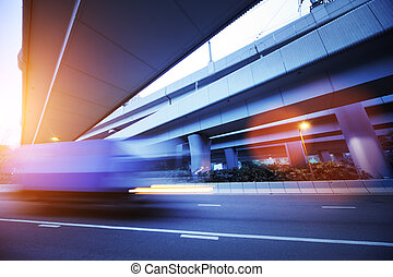 Transportation background - Small truck speeding under...