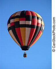 Hot air ballooners traversing a deep blue sky
