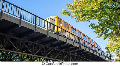 Transportation means. Yellow electric train, Berlin, ...