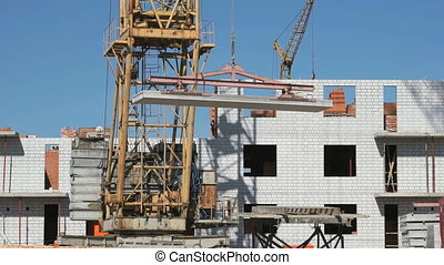 Transportation of the concrete slab using a crane - The...